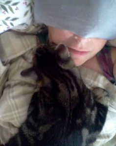 Portrait of the artist recovering with her cat